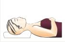 Pozycja śpiącego na poduszce anatomicznej ortopedycznej (na plecach)